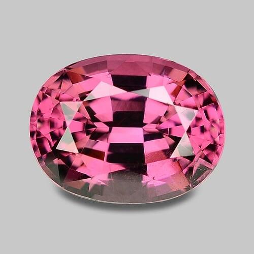 Natural precision oval cut, pink Mahenge rhodolite garnet.