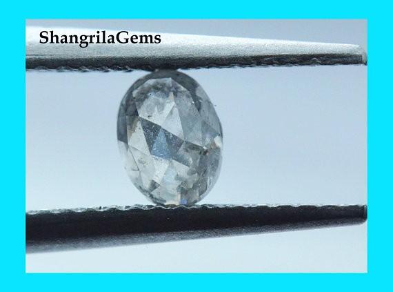 5.25mm 0.555ct salt pepper oval diamond 5.25 by 4 by 2.8mm from Botswana