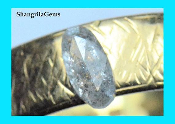 6.6mm 0.485ct salt pepper oval diamond 6.6 by 3.3 by 2.1mm from Botswana