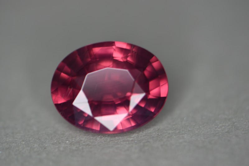 Beautiful richly saturated but not dark color orangey-pink padparadscha like color.