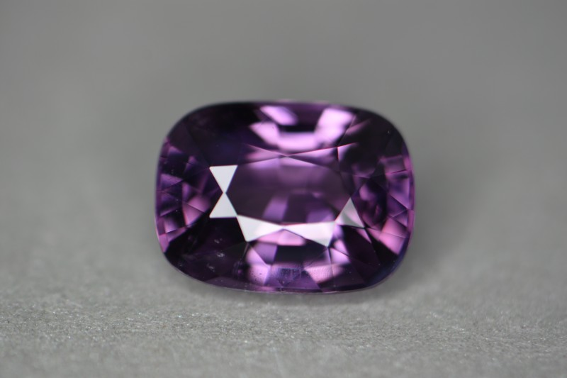 Rich purple saturated color.   Not a dark stone.   Nice open color.