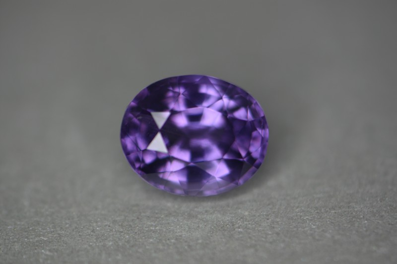 Beautiful violet spinel.  I like the color of this sto ne.  Has a nice flash and good luster as well.  Priced very good for the size.