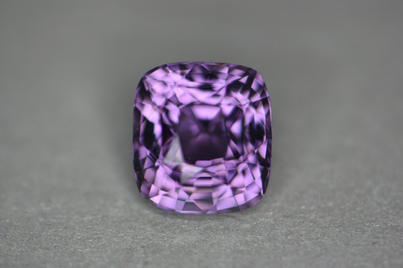 Just gorgeous violet certified color.   No surface enhancements.   No treatment on this stone.
