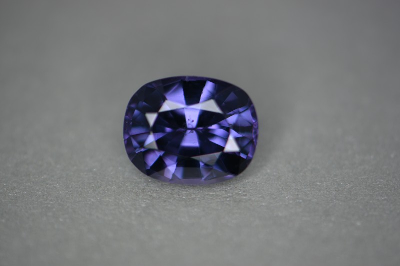 Violet color inside light incandescent.  Outside video is shaded light and you see the alexandrite effect of blue and violet at the same time.    Stronger violet inside light.