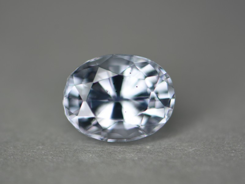 Light bluish tinted spinel.  Certification says pale violet.   Perhaps under inside light it slightly changes tones but I didn't see it.