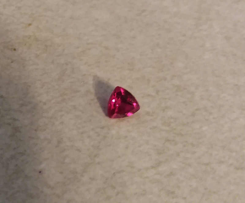 RED TOPAZ .60 CARAT WEIGHT RED AZOTIC TOPAZ TRILLION CUT GEMSTONE