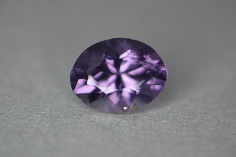 Really pretty highly lustrous natural spinel with no treatments.  Certified.   Properly cut as you can see by the internal flash coming out of the center of the stone.