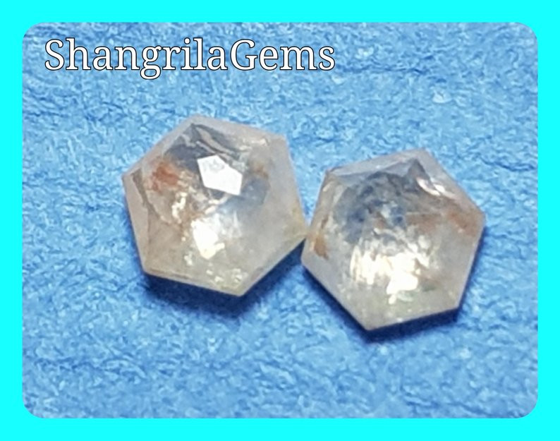 0.24ct 3.2mm pair Hexagon diamonds white with orange peach tint