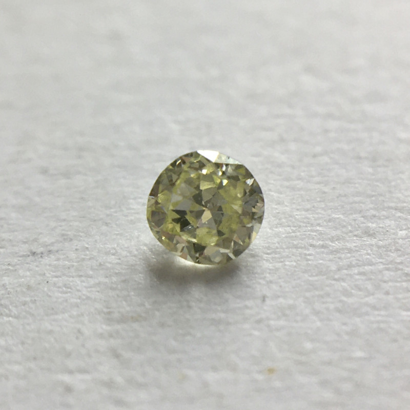 0.04 ct Fancy Yellow Green I1 Round Brilliant Diamond