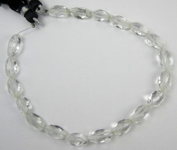 AAA+ CRYSTAL QUARTZ 5X10-6X11MM FACETED CARDAMON BEADS