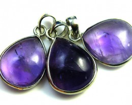 THREE CABOCHON AMETHYST  SET IN  PENDANTS  AAA2089