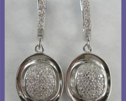 Photo appears to show the oval surround off-skew but this is not the case - beautiful earrings.