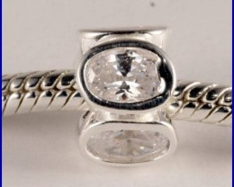 Sterling Silver Charm set with created Topaz SG35