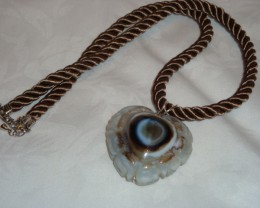 CARVED TIBETAN AGATE PENDANT ON CORD
