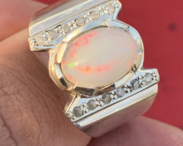 Natural Opal and diamonds Ring.