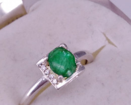 Natural Emerald and CZ Ring.
