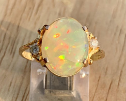 18K Gold Natural Opal and Diamonds Ring .