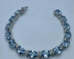 Natural Swiss blue topaz bracelet TCW 42.2 .