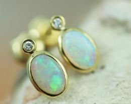 Cute Crystal  Opal set in 14k Yellow Gold Earring CK 501