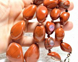 958.0 Tcw. Highly Polished Orange Agate Graduated Pebble Necklace