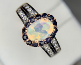 Natural Opal, sapphire and white topaz Ring.
