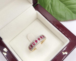 Centralls channel set Pigeon Blood Ruby, flanked diamond 9KYellow gold Ring