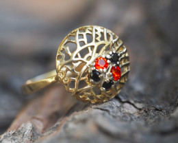 Gold ring with sapphires and spinels.
