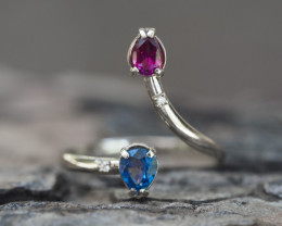 Gold ring with sapphire and garnet.