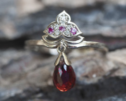 Gold ring with garnet, sapphires and diamonds