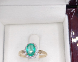 Solitaire Colombian Emerald 14K  gold Ring, Set with diamond to shoulders