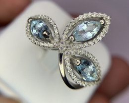Natural Swiss Blue Topaz ring With CZ.