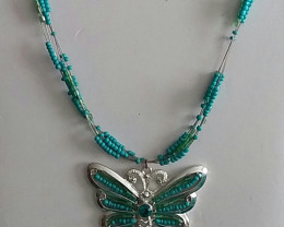 VINTAGE TURQUOISE COLORED BEADED BUTTERFLY NECKLACE - ADJUSTABLE
