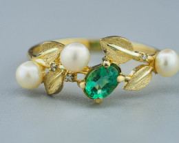 14k solid gold ring with emerald, pearls and diamonds.