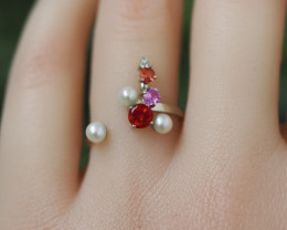 14 kt Yellow gold ring with ruby, amethyst, diamonds, garnet, pearls, ruby.
