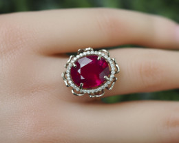 Massive flower gold ring with ruby and diamonds.