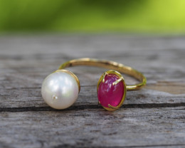 Gold ring with ruby, pearl and diamond.