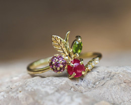 14k yellow gold ring with ruby, rose sapphires, tourmaline and diamonds.