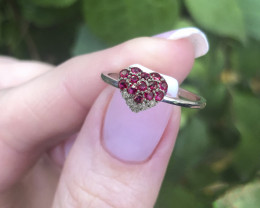 Gold ring with rubies and diamonds.