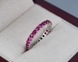 Eternity ring with natural princess cut rubies.