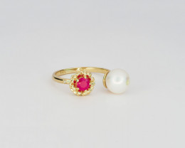 14k gold ring with ruby, pearl and diamond.