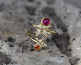 14k gold ring with ruby, sapphire and diamonds.