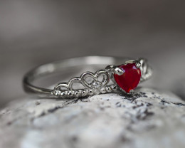 14k gold with heart ruby and diamonds.