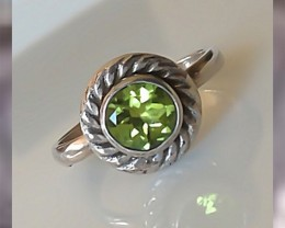 A Beautiful Peridot Ring in Two tones of Sterling Silver