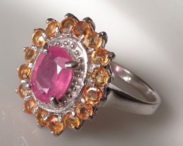 A RUBY SAPPHIRE STERLING SILVER RING