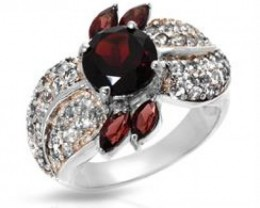 NEW-RING WITH 3.00CTW OF GARNETS AND TOPAZES SET IN 925 STERLING SILVER