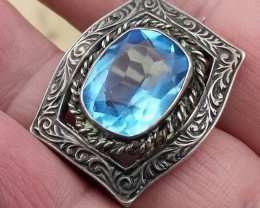 ANTIQUE BROOCH WITH BLUE TOPAZ AND STERLING SILVER
