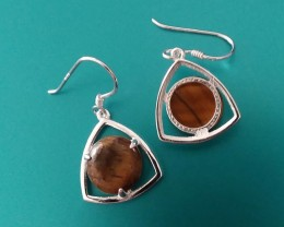 STERLING SILVER CAST,  HALLMARK 925 ON BACK OF EARRINGS CAST.
