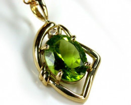 HIGH GRADE PERIDOT WITH DIAMOND SET 18 K GOLD EM333