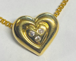 2.79 Grams  Heart shape pendant ,diamonds 18k gold LGN950