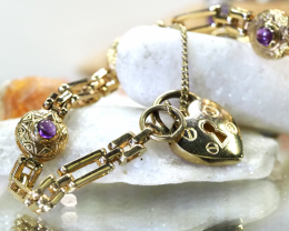 17.08 grams 9 K GOLD BRACELET WITH AMETHYST GEMSTONES L 426